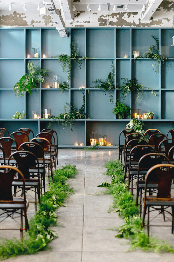 The venue was truly industrial, even the leather and metal chairs but softened with greenery