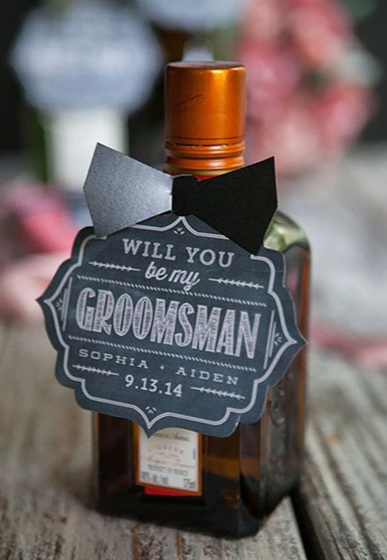 a bottle of alcohol with a chalkboard tags is an easy piece to make