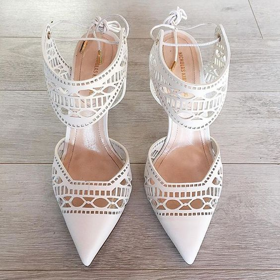 ankle strap laser cut white wedding shoes for a fashion forward bride