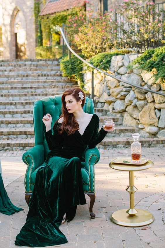 emerald velvet wedding dress with a train, long sleeves and a deep V neckline