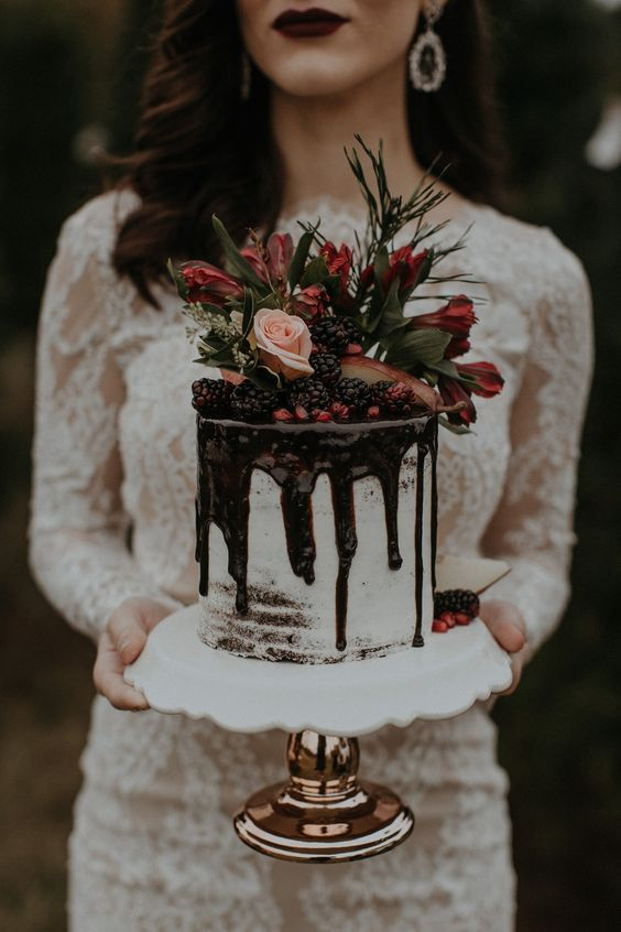 semi naked wedding cake with chocolate drip, blackberries, pomegranate and fresh flowers