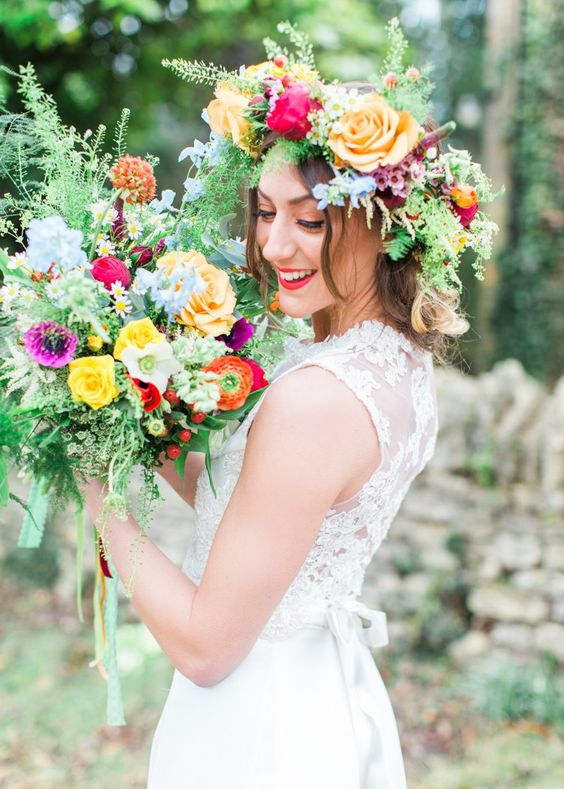super bold flower crown with orange, fuchsia and red blooms and different greenery
