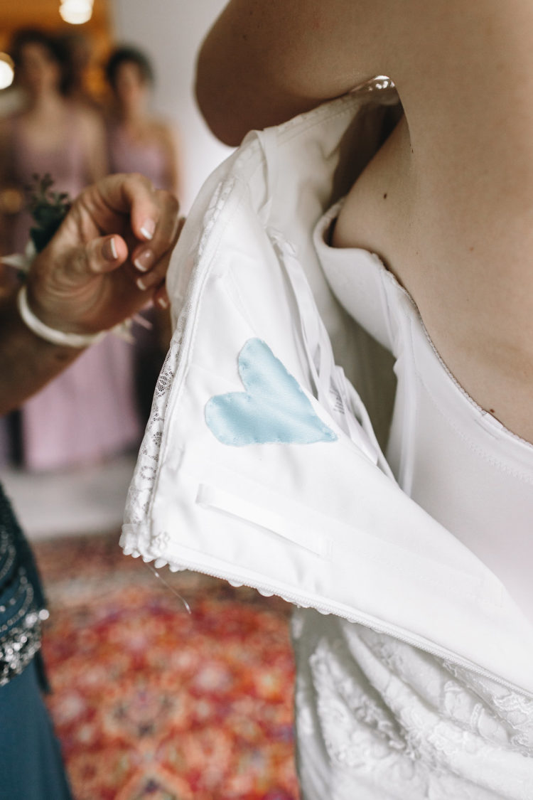 the bride included a something blue touch - a blue heart sewn into her dress