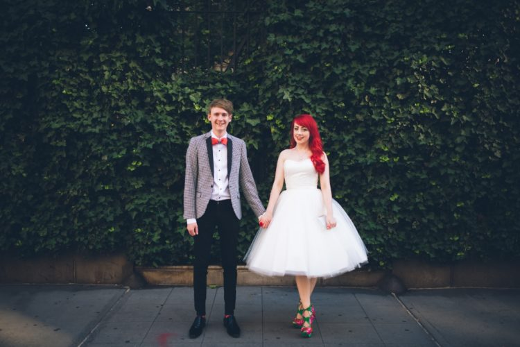 She was also rocking a short strapless wedding dress with a tulle skirt and red hair