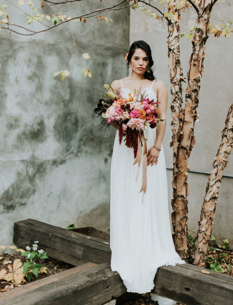 The bride was carrying a gorgeous textural bouquet with pos of color