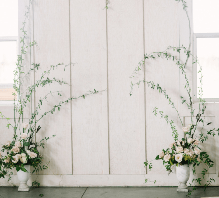 The ceremony space was defined by two vases with blush roses and greenery