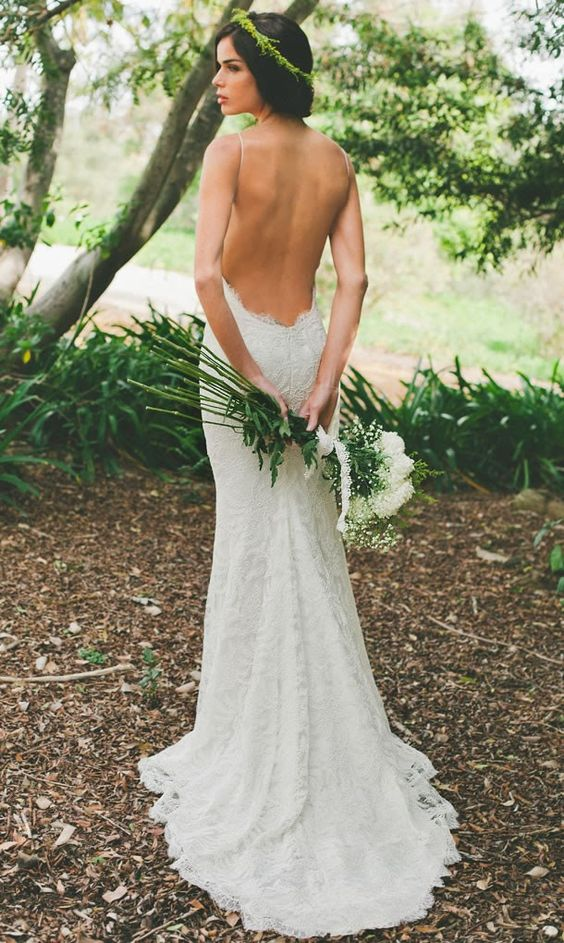 a backless lace wedding dress with spagheetti straps will let your skin breathe
