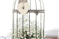 03 a vintage bird cage with baby's breath