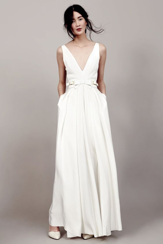 Modern Plain Wedding Gown With A V Neckline Pockets And White Leather Belt