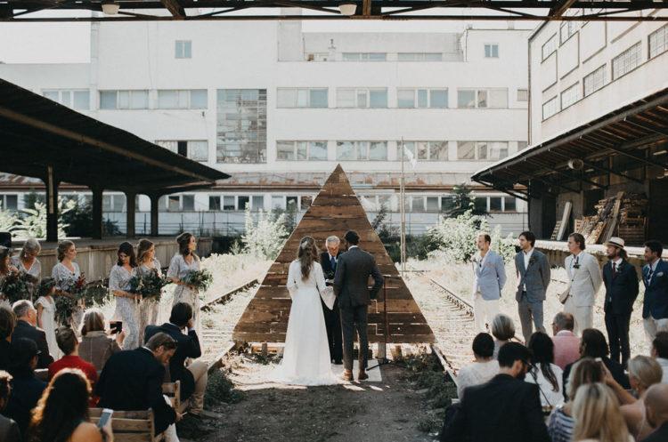 A cone-like reclaimed wooden backdrop has a Scandinavian flavor