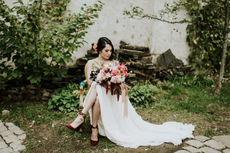 I totally love her burgundy shoes that match the bouquet