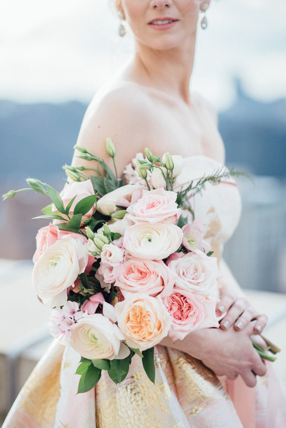 The bridal bouquet consisted of pink peonies, roses and ranunculus, who needs more