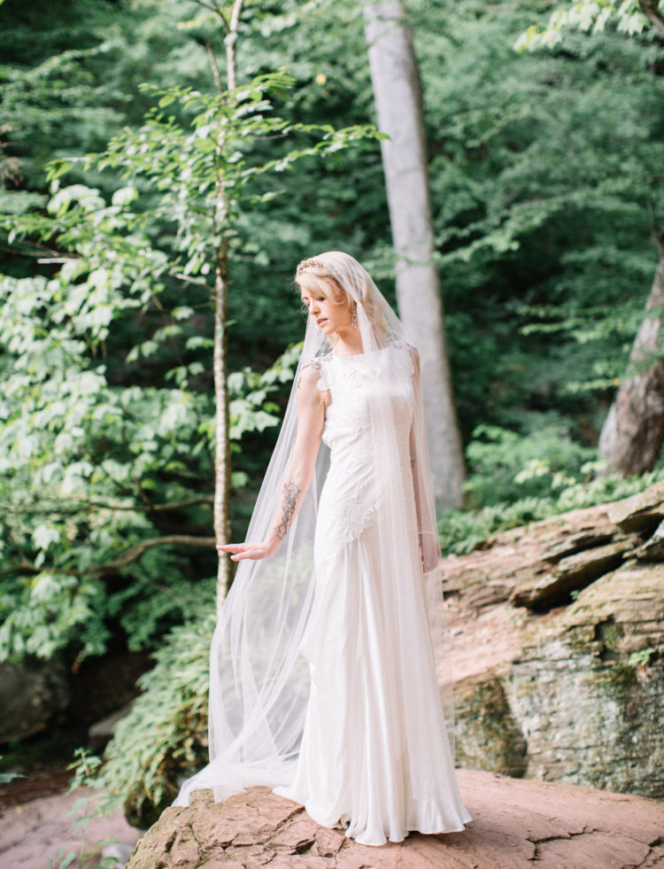 The bride was wearing a Carol Hannah gown with lace appliques and jeweled cap sleeves, a long veil