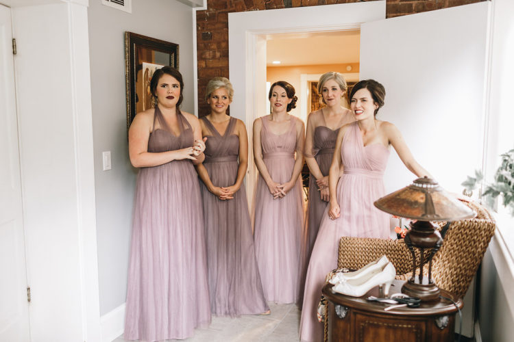 The bridesmaids were wearing mismatching lavender dresses