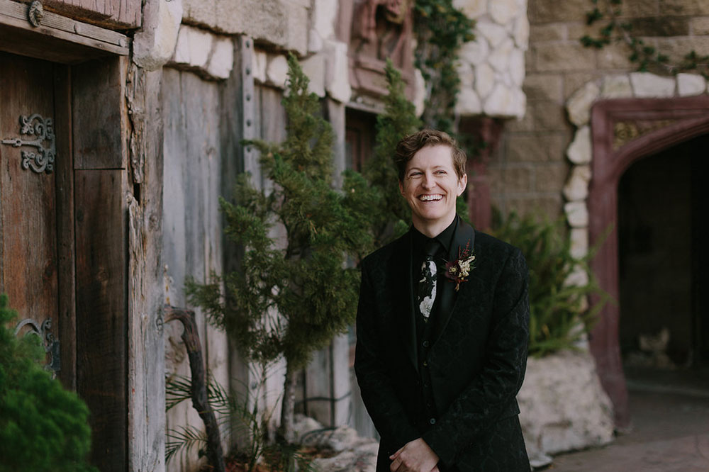 The groom was dressed in a textural suit, a black shirt and a patterned tie