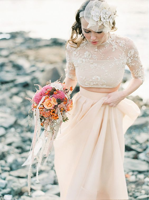 a blush plain pleated skirt and a lace applique crop top with an illusion neckline and half sleeves