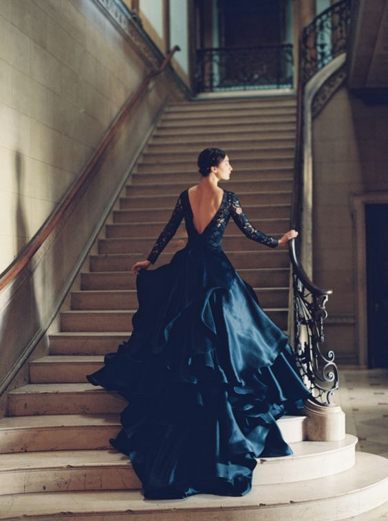 ballgown with a lace bodice with long sleeves, a deep V neck cut and a ruffled satin skirt