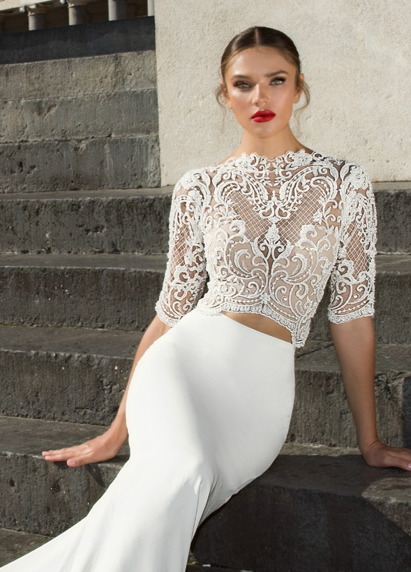 two piece wedding dress with a lace applique bodice and half sleeves and a plain mermaid skirt