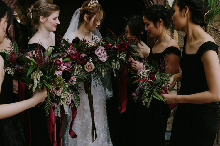 The bridesmaids were rocking black maxi gowns and all the girls were carrying moody bouquets