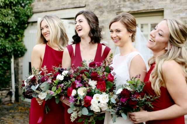 The bridesmaids were rocking mismatching berry-hued dresses