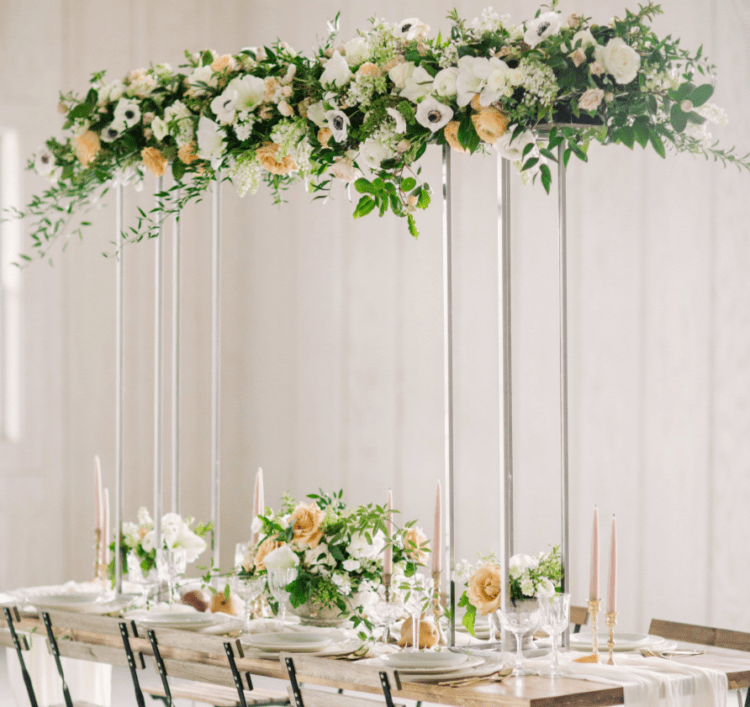 The wedding tablescape was made eye-catchy with the help of a cool floral installation above the table