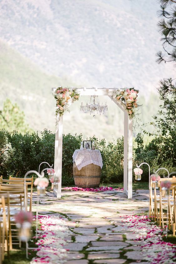 a crystal chandlier makes this rustic ceremony space more glam