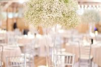 05 a tall cone glass vase with baby's breath is a great fit for many wedding styles
