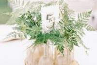 05 evergreens in glass tubes on a wood slice for a simple green centerpiece
