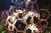 05 hexagon wedding backdrop with lush pink and white flowers and candle bubbles