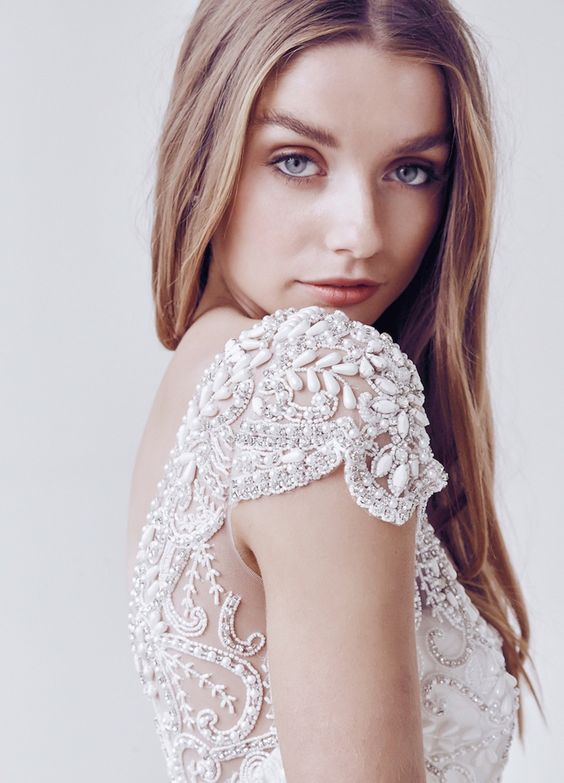 lace cap sleeve with silver embroidery and large drop-shaped pearls