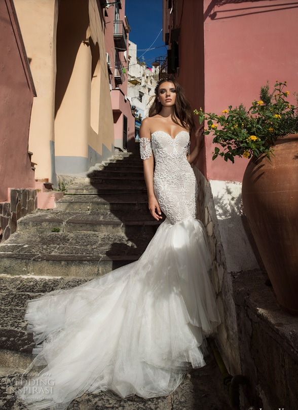 off the shoulder mermaid dress with a lace applique bodice and partly skirt and a ruffled tulle tail