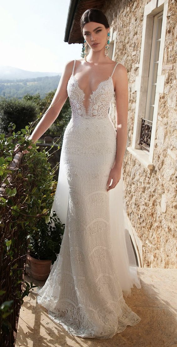 spaghetti strap lace wedding dress with a sheer bodice looks very sexy