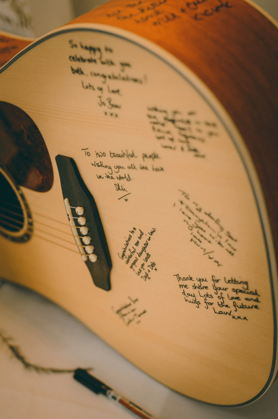 A guitar was used istead of a guestbook, the couple hung it on the wall at home