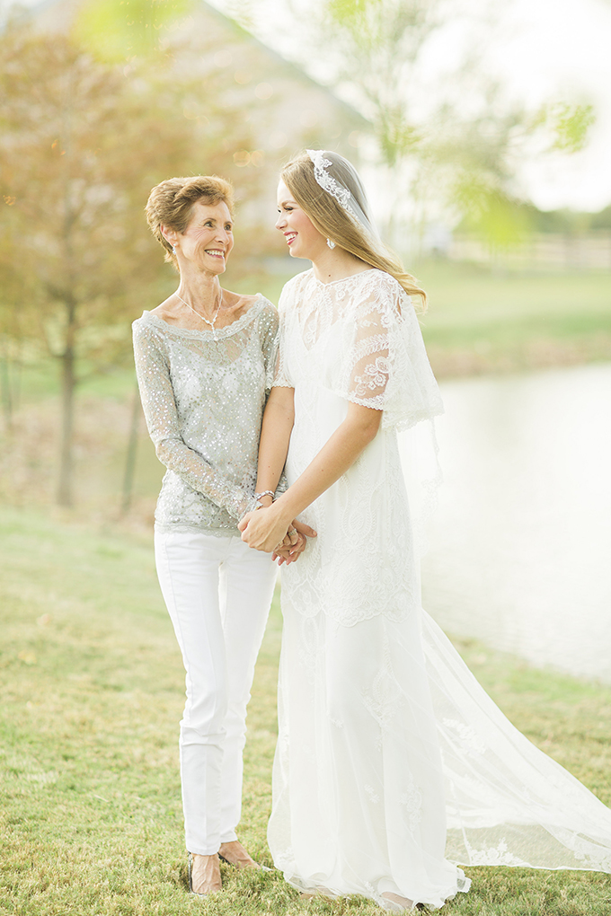 The bride with her mom, dress in a chic modern way, with white jeans and an embellished shirt