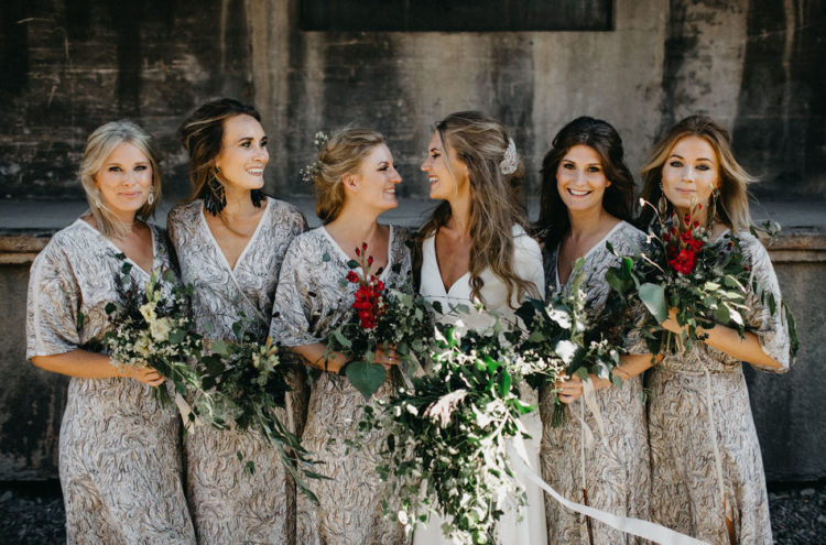 The bridesmaids were wearing V-neck printed grey dresses