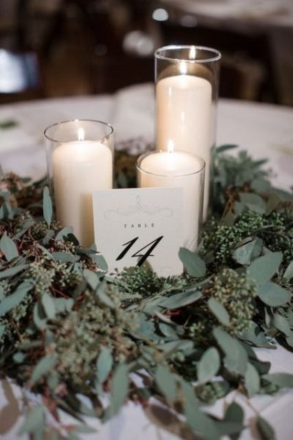 candles wrapped with fresh eucalyptus can work as a centerpiece