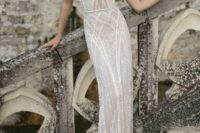 06 light sparkling wedding dress with thin spaghetti straps and a cutout bodice
