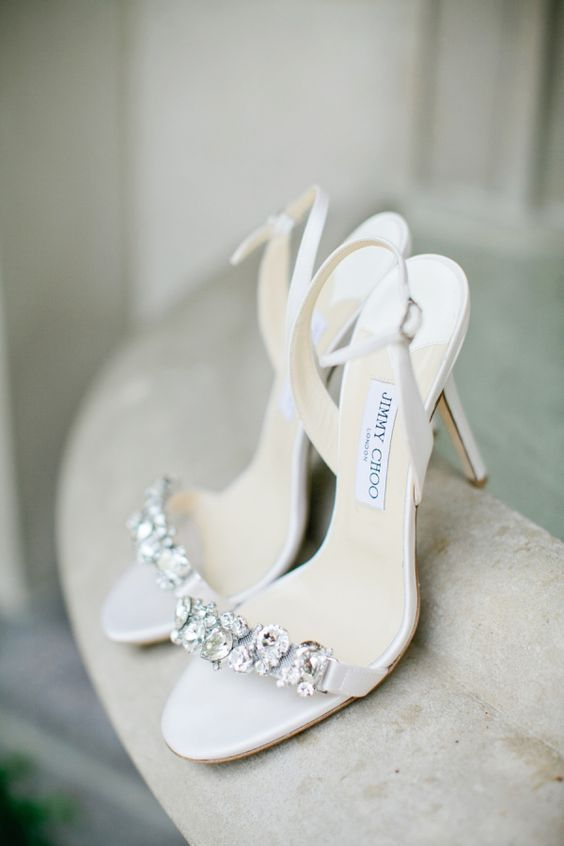 white jeweled sandals on heels by Jimmy Choo for an elegant bride