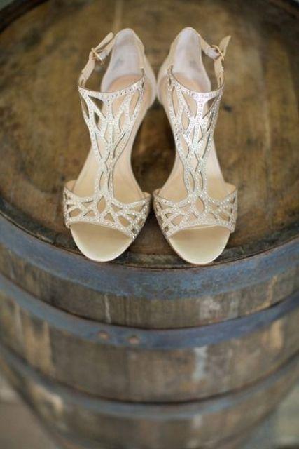 gold, laser-cut, strappy heels with sparkling rhinestones