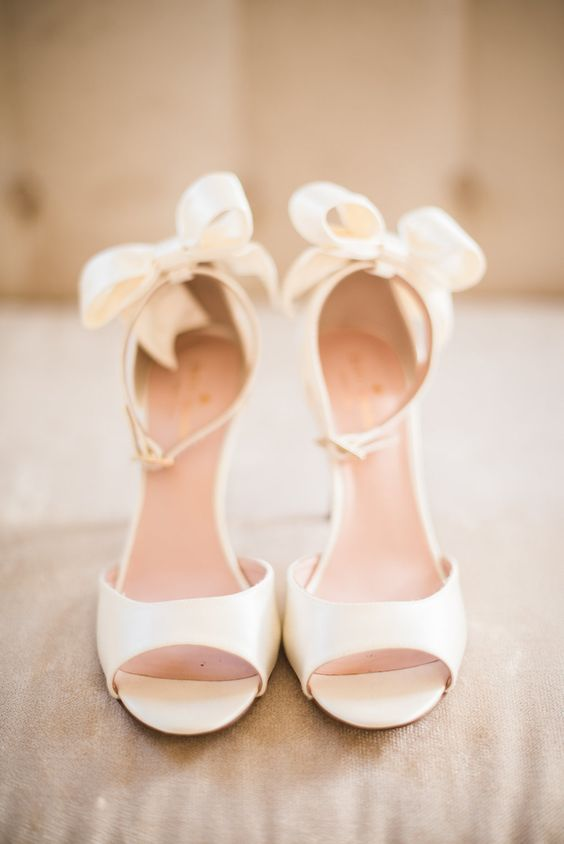 ivory ankle strap peep toe shoes with bows on the back
