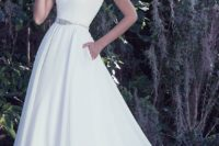 07 modern plain white scoop neckline A-line wedding gown with an embellished sash and pockets