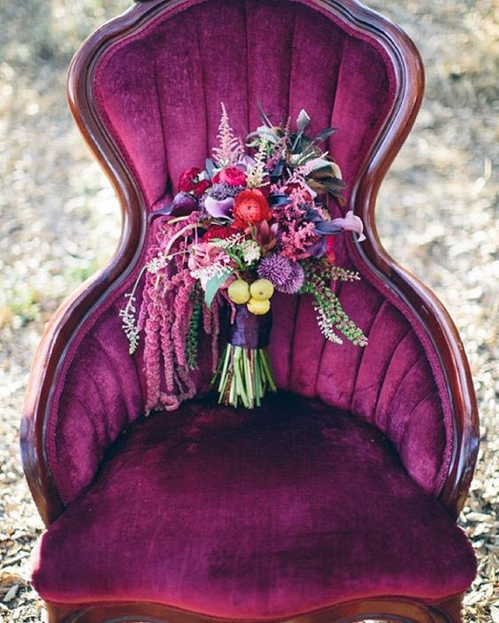 super bold pink, purple, red and burgundy wedidng bouquet with a dark purple wrap