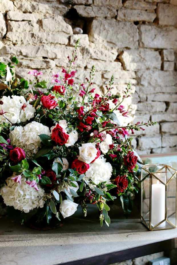 Gorgeous lush florals with berry hues could be seen everywhere