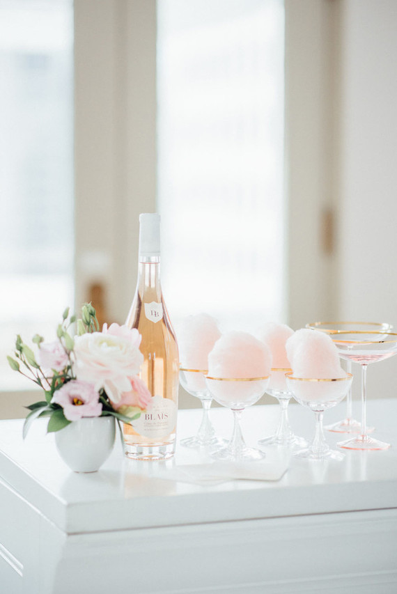Pink desserts and champagne for serving at a rose-inspired wedidng