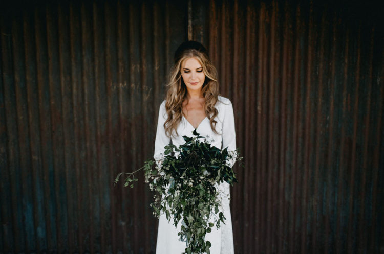 She was carrying a lush textural greenery bouquet