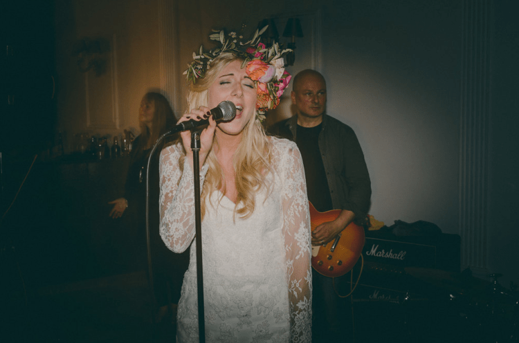 The bride was singing herself with the band