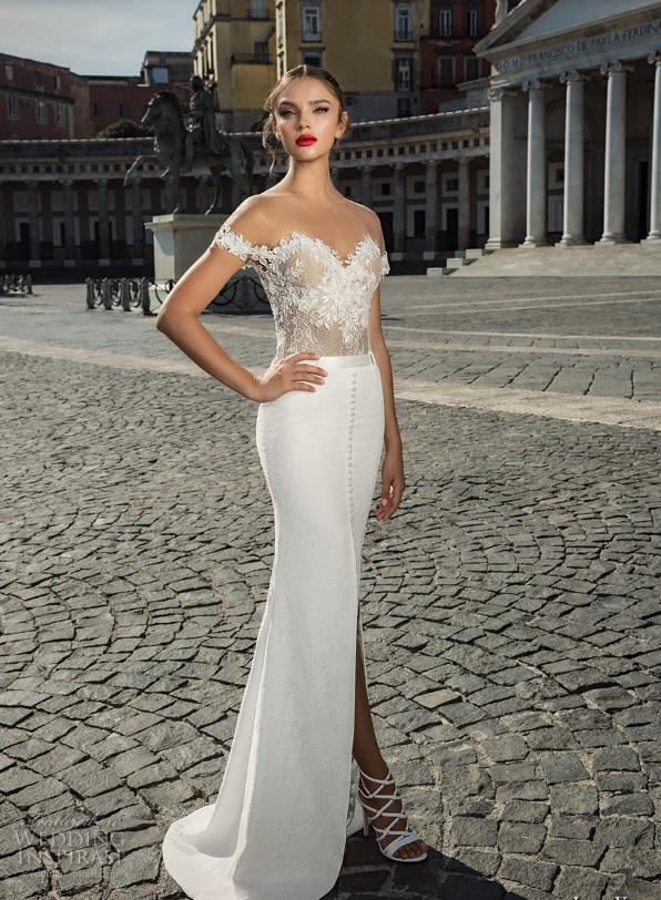 a white illusion off the shoulder wedding gown with a lace applique bodice and a plain skirt with a slit and a row of buttons