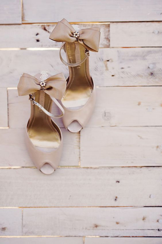 champagne colored peep toe ankle strap shoes with large bows