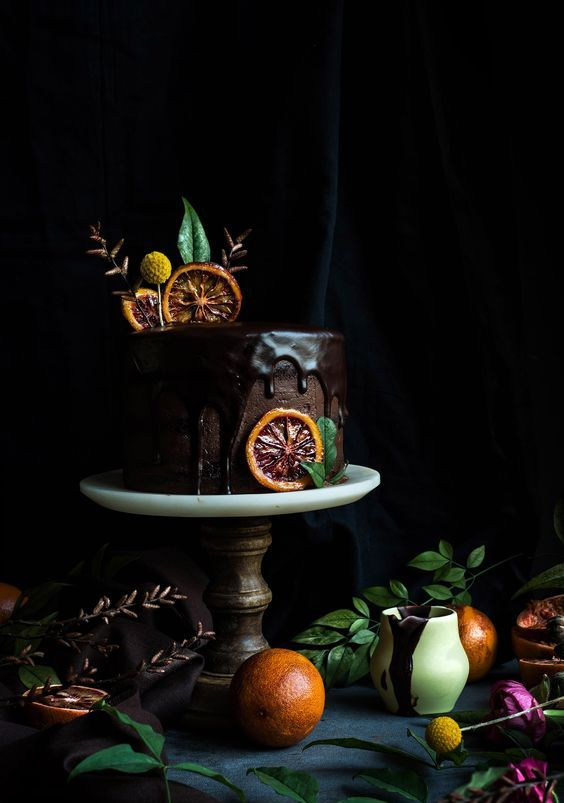 chocolate cake with chocolate drip and blood orange slices