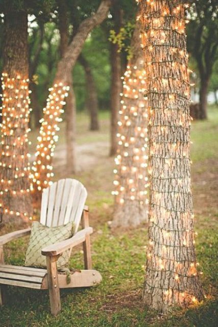 cover the trees with light strings all around and you'll get a gorgeously lit reception
